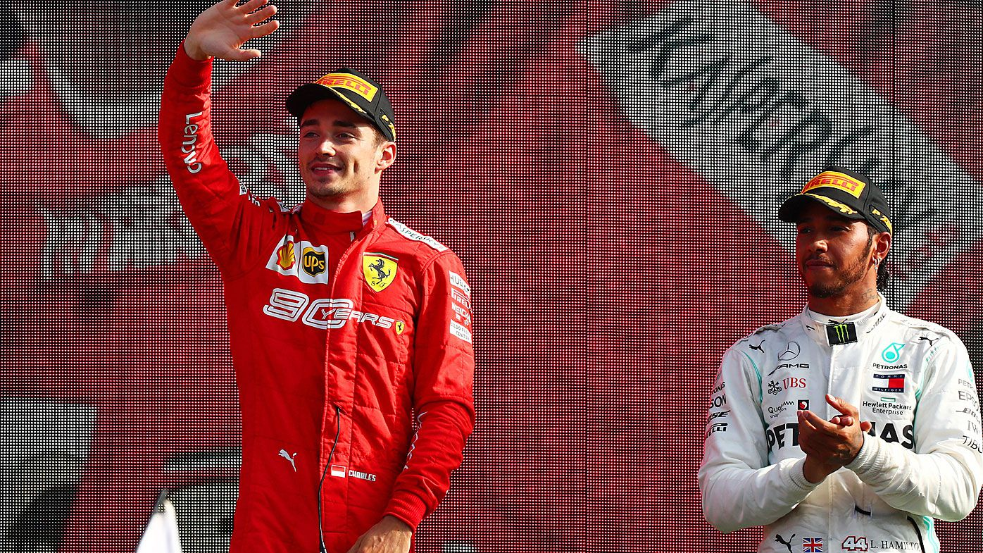Race winner Charles Leclerc of Monaco and Ferrari is applauded by third placed Lewis Hamilton