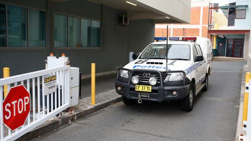 A New South Wales police vehicle leaves the Southport Watch House on the Gold Coast. (AAP)