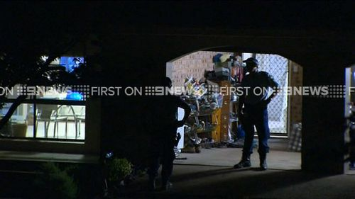 Police also raided a home in Bonny Hills. (9NEWS)