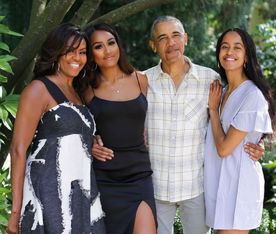 Michelle and Barack Obama with daughters Sasha, 18, (left) and Malia, 21.