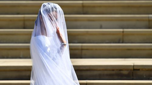 Ms Markle waves to the crowds outside the chapel. Picture: AP