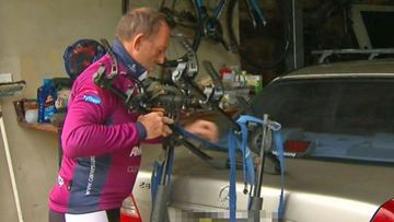 Tony Abbott goes for a bike ride after loosing his seat.
