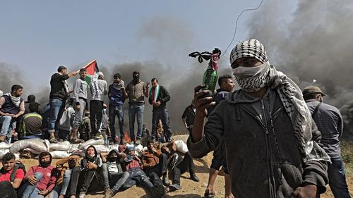 Palestinians protesters near the border with Israel. (AAP)