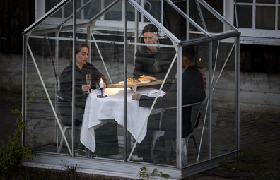 Dinner is served during a test evening in so-called quarantine greenhouses in Amsterdam, The Netherlands