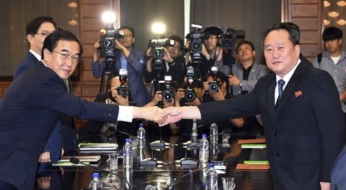South Korean Unification Minister Cho Myoung-gyon, left, shakes hands with his North Korean counterpart Ri Son Gwon during their meeting at the northern side of Panmunjom in the Demilitarized Zone, North Korea, Aug. 13, 2018