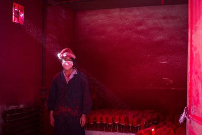 <p>Red powder used as colouring hovers in the air, and the two go through about 10 face masks a day trying not to breathe it in. Although he wears a Christmas hat at work, Wei's father doesn't intend on celebrating the holiday. </p><p> The hat protects his hair from the red dust—which covers them from head to toe like soot after several hours of work. </p><p> </p>
