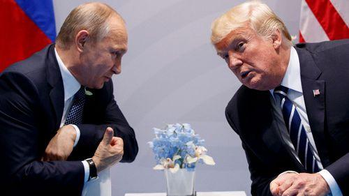 Vladimir Putin and Donald Trump speak privately.