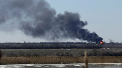 An explosion is seen from a shelled gas pipe near a power station, not far from Debaltseve in Ukraine. (AAP)
