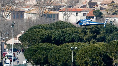 A helicopter arrives at the scene. (AP/AAP)
