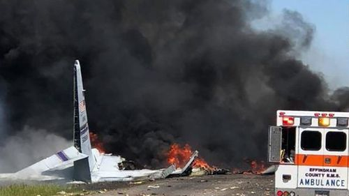 Emergency teams respond to US military plane crash near an International airport in Georgia