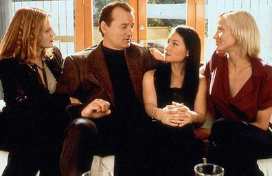 Drew Barrymore, Bill Murray, Lucy Liu and Cameron Diaz on the set of Charlie's Angels.