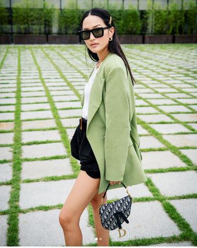 Style blogger Nicole Warne ( Gary Pepper Girl) with a Dior Saddle Bag