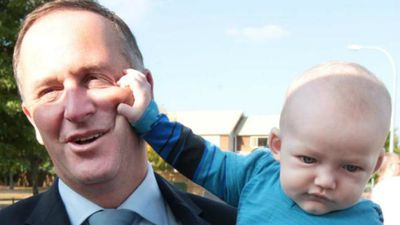 New Zealand PM John Key comes to grips with a young fan in Hamilton.
