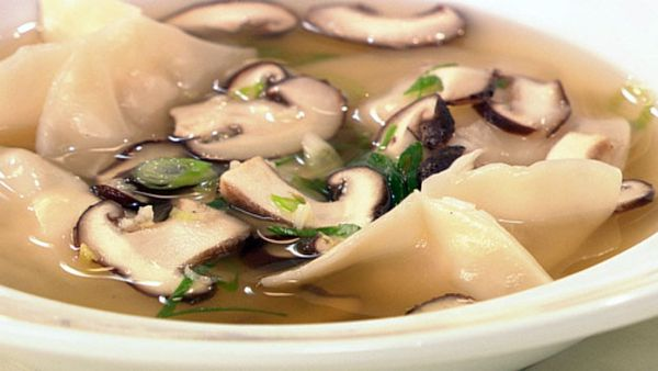 Chicken and prawn dumplings in chicken broth with shitake mushrooms and spring onion