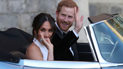 FILE - In this Saturday, May 19, 2018 file photo the newly married Duke and Duchess of Sussex, Meghan Markle and Prince Harry, leave Windsor Castle in a convertible car after their wedding in Windsor, England, to attend an evening reception at Frogmore House, hosted by the Prince of Wales. Prince Harry and his wife Meghan are ending their lives as senior members of Britains royal family and starting an uncertain new chapter as international celebrities and charity patrons. In January the couple