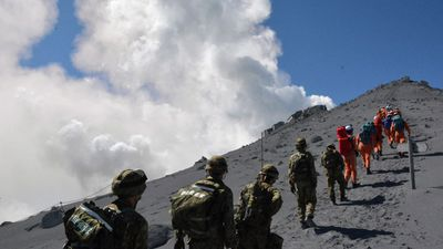 Rescuers are still searching for some of the bodies from the September 27 eruption. (EPA, Japanse Defense Ministry)