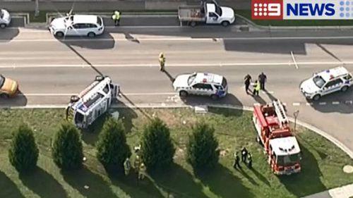 Ambulance rolls after crash north of Melbourne