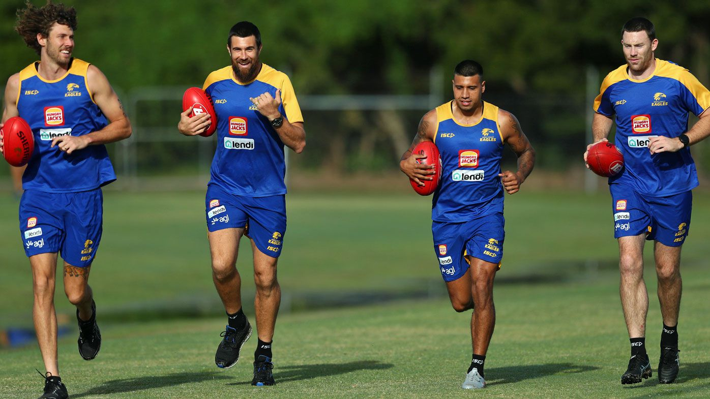 Tom Hickey, Josh Kennedy, Tim Kelly and Jeremy McGovern run during a West Coast Eagles Training Session