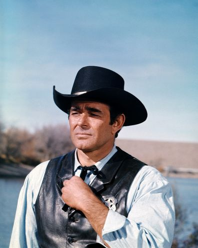 US actor Stuart Whitman wearing a black Western hat and black leather waistcoat with a sheriff's badge in a scene from the American western television series 'Cimarron Strip', USA, circa 1967. (Photo by Silver Screen Collection/Getty Images)