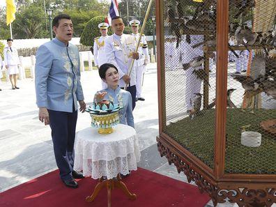 Thai King Maha Vajiralongkorn, left, and his royal noble consort Sineenat Wongvajirabhakdi release birds during a merit-making ceremony for her 36th birthday in Bangkok, Thailand, on Tuesday, Jan. 26, 2021. Thai royal noble consort Sineenat was born on Jan. 26, 1985 .(AP Photo)