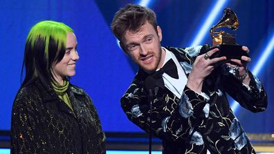 Billie Eilish and Finneas O'Connell accept the Song of the Year award for 'Bad Guy' onstage during the 62nd Annual GRAMMY Awards.