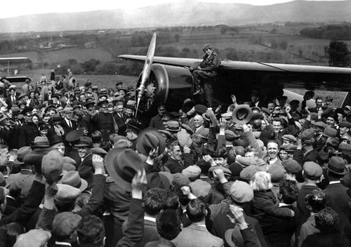 A crowd cheers for aviatrix Amelia Earhart as she boards her single-engine Lockheed Vega airplane in Londonderry, Northern Ireland, for the trip back to London on May 22, 1932. Earhart became the first woman to fly solo nonstop across the Atlantic Ocean when she finished her 3260km journey on May 21, 1932 in under 15 hours after departing from Harbour Grace, Newfoundland. Earhart vanished mysteriously over the Pacific during her attempted round-the-world flight in 1937.