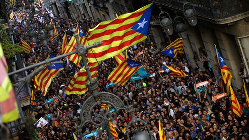 Pro-independence supporters gather near the Palau Generalitat in Barcelona, Spain. (AP)