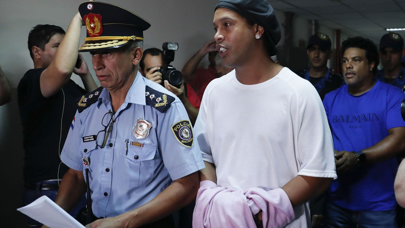 Ex-football megastar Ronaldinho must remain in Paraguayan jail after passport bust