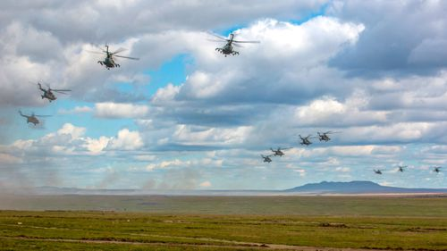 Russian military helicopters fly, in the Chita region, Eastern Siberia, during the Vostok 2018 exercises in Russia.