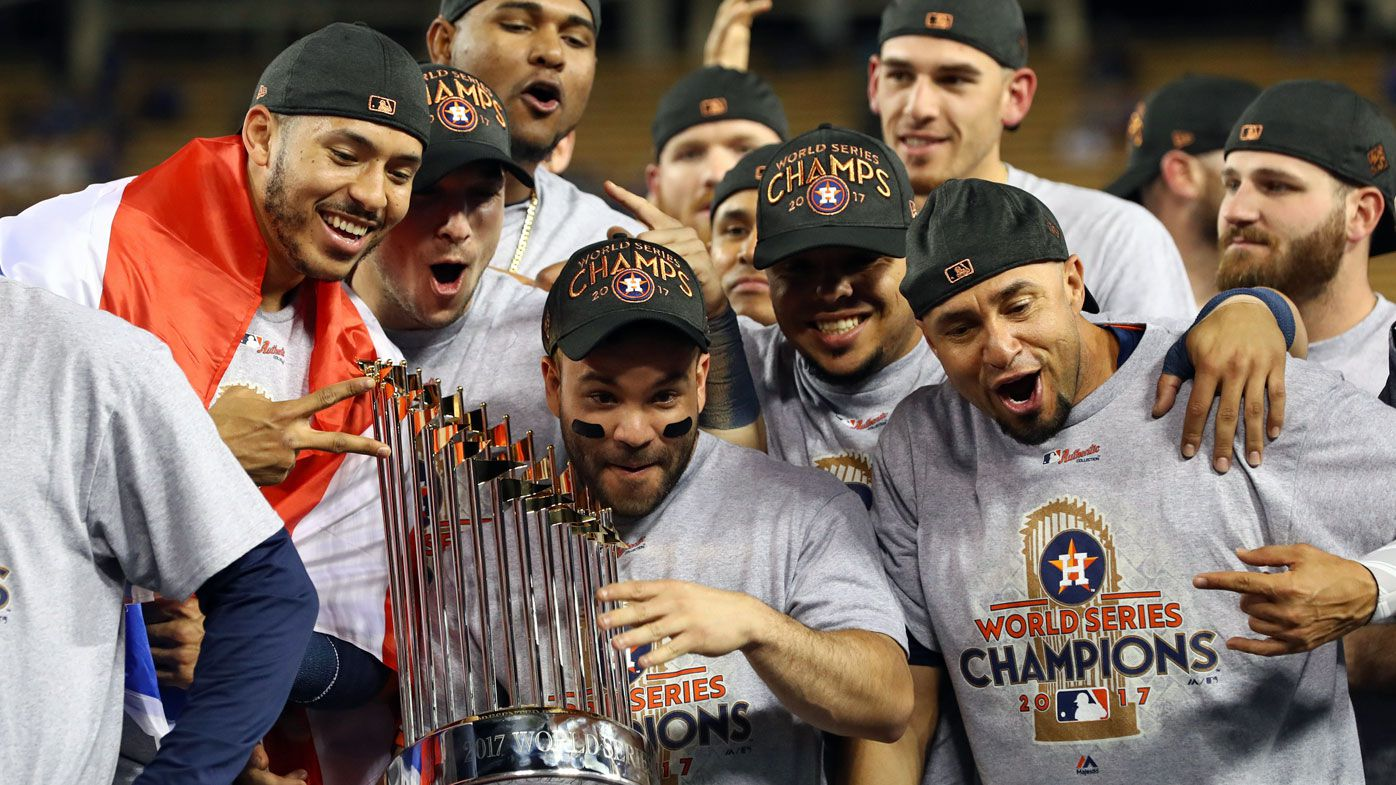 Carlos Correa #1, Jose Altuve #27  and teammates celebrate with other Houston Astros