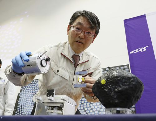 Takashi Kubota explains space probe Hayabusa2 will create an artificial crater in a designated area on the Ryugu asteroid to get samples.