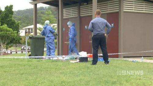 Forensics police examine a toilet block located near the crime scene. (9NEWS)