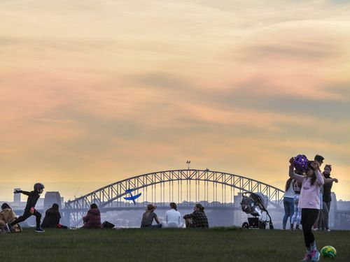 Sydney residents make the most of a sunny day in Dover Heights