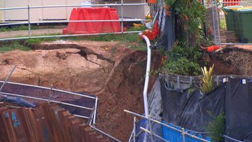 Residents stranded as retaining wall collapses at construction site