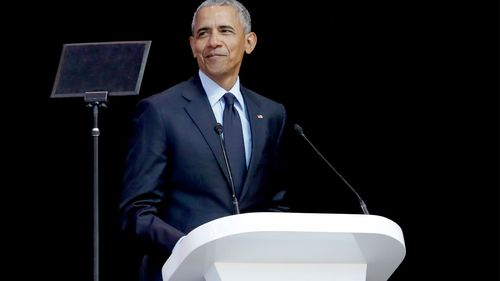 Former US President Barack Obama delivers his speech at the 16th Annual Nelson Mandela Lecture at the Wanderers Stadium in Johannesburg, South Africa. (AAP)