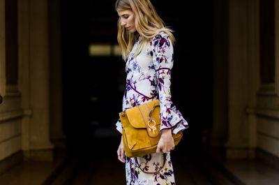 Veronika Heilbrunner wearing a dress with floral print and a Chloe Lexa bag, Paris Fashion Week