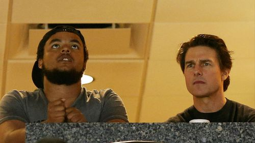 Tom Cruise (R) and his son Connor Cruise watch the Maryland Terrapins play against the Connecticut Huskies during the NCAA Women's Final Four Semifinal at Amalie Arena in 2015. (AFP)