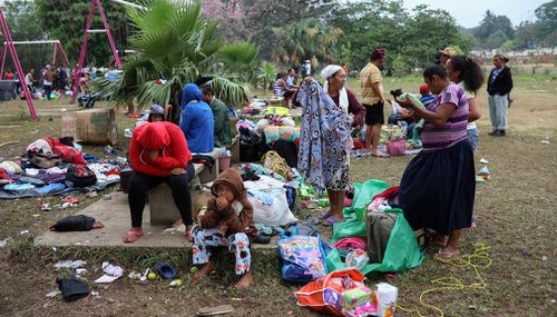 """Central American migrants traveling with the annual """"Stations of the Cross"""" caravan pack up their belongings as they prepare to depart from the sports club where they have been camping out in Mexico. (AP)"""
