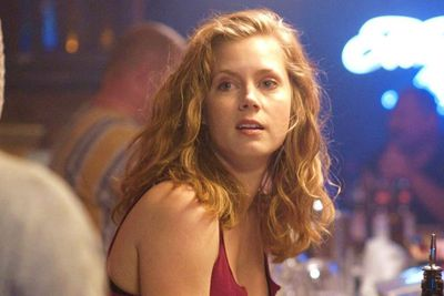 """We were<i> Enchanted</i> by her Disney-lite Princess Giselle and loved her home cooking in <i>Julie & Julia,</i> but Amy Adams is more than just a girl-next-door. Director David O. Russell chose her for the part of bad-ass bartender Charlene in<i> The Fighter,</i> a """"tough, sexy bitch"""". It earned her a third Oscar nomination."""