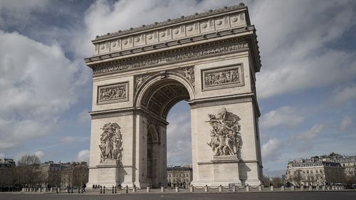 The Arc de Triomphe is deserted after French President Emmanuel Macron has declared a ban on all gathering of more than 100 people and the closure of all schools, restaurants, bars, cafes and clubs in response to the spread of the coronavirus.