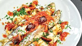 Pan fried sardine salad with tomatoes, olives and rocket