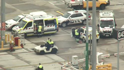 Emergency crews waited for the plane near the gate at Melbourne Airport.