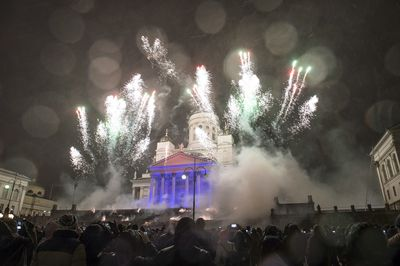 Helsinki Cathedral lights up as as people celebrate New Year 2019 on the Senate Square in Helsinki, Finland.