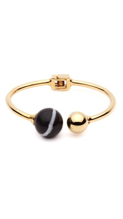 "<a href=""http://ambersceats.com/product/the-bentley-bangle-3/"" target=""_blank"">The Bentley Bangle, $139, Amber Sceats</a>"