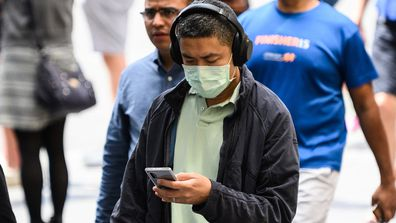 A man wearing a protective face mask seen in Sydney, Monday, March 2, 2020. (AAP Image/James Gourley) NO ARCHIVING