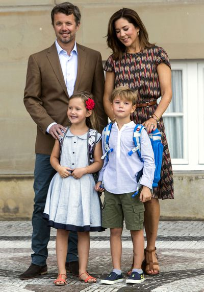 The family looked sweet as they stood outside the school to have their picture taken.