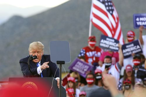 President Donald Trump speaks at a campaign rally at Carson City Airport, in Nevada.