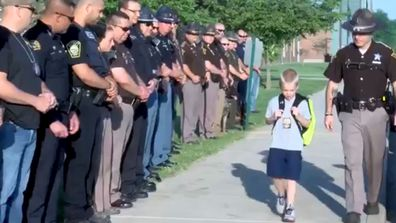 70 Indiana Police Officer formed a guard of honour for boy whose father was killed in the line of duty. (BBC)