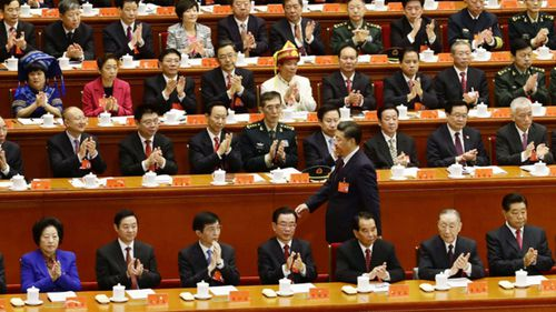 Chinese President Xi Jinping walks to deliver a speech at Beijing's Great Hall of the People. (AAP)