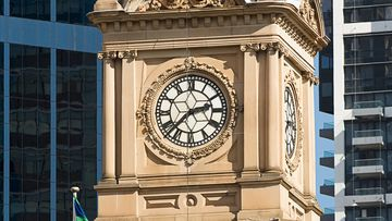 Sydney's Town Hall clock. NSW is one of several states that will be setting their clocks forward by one hour tomorrow. (Getty)